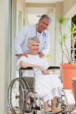 Doctor with his patient. Looking at the camera Stock Photography