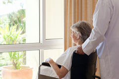 Doctor with his patient. Looking out the window Stock Image