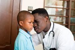 Doctor and his patient in his clinic stock photo