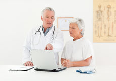 Doctor and his patient looking at the laptop Stock Image