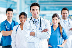 Doctor with his team Royalty Free Stock Image