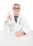 Doctor at his working desk having some idea Stock Image