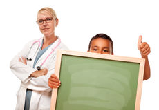 Doctor with Hispanic Child Holding Chalk Board Royalty Free Stock Image