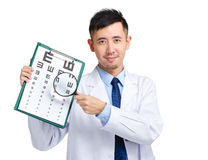 Doctor hold with eye chart and magnifying glass Royalty Free Stock Photography