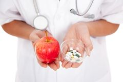 Doctor  hold medicine and apple Royalty Free Stock Photography
