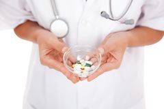 Doctor  hold medicine with both hand Stock Photos