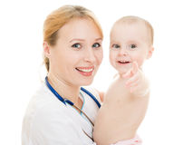 Doctor Holding A Baby In Her Arms Stock Photo