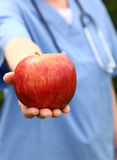 Doctor Holding Apple Stock Photos