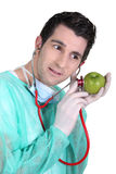 Doctor holding an apple Royalty Free Stock Images