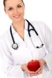 Doctor holding apple stock photo