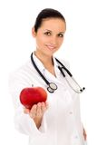 Doctor holding apple Stock Images