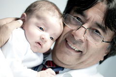 Doctor holding a baby Stock Photography