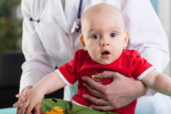 Doctor holding a baby Royalty Free Stock Photography