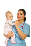 Doctor holding baby girl Stock Photography