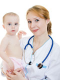 Doctor holding a baby in her arms Stock Image
