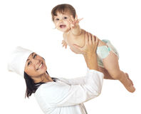 Doctor holding baby over his head. Royalty Free Stock Image