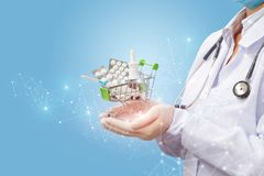 Doctor is holding a basket of medicines . Doctor is holding a basket of medicines on the background network Stock Image