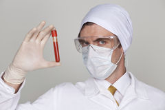 Doctor holding a beaker of blood Stock Photo