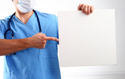 Doctor holding blank banner , standing on white background Stock Image