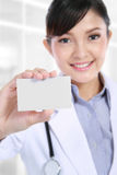 Doctor holding blank business card Royalty Free Stock Image