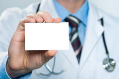 Doctor holding blank business card Stock Photos