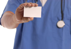 Doctor holding blank card Royalty Free Stock Images