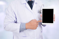 Doctor holding blank digital tablet Royalty Free Stock Image