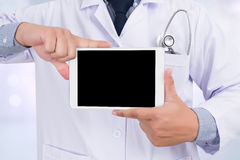 Doctor holding blank digital tablet Stock Photo