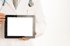 Doctor holding blank digital tablet  on white background Royalty Free Stock Photo