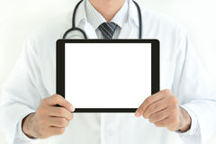 Doctor holding blank screen tablet pc Stock Photo