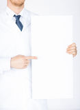Doctor holding blank white banner Royalty Free Stock Photo