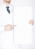 Doctor holding blank white banner Royalty Free Stock Photos