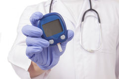 Doctor holding blood sugar meter Royalty Free Stock Photos