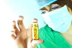 Doctor holding a bottle of pills Stock Photos