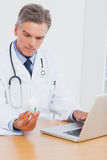 Doctor holding a bottle of pills Stock Photography