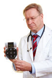 Doctor holding calculator Royalty Free Stock Photos