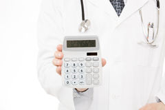Doctor holding calculator - health care concept Royalty Free Stock Image