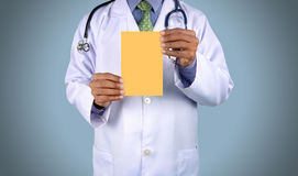 Doctor holding card with stethoscope. Isolated on color backgroun Royalty Free Stock Images
