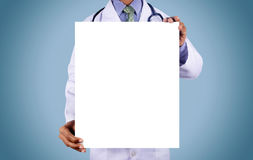Doctor holding card with stethoscope. Isolated on color background Royalty Free Stock Images