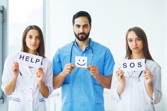 Doctor holding a card with Symbol Smile. Help and Sos, Medical c. Oncept stock photos