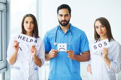 Doctor holding a card with Symbol Smile. Help and Sos, Medical c. Oncept stock photo