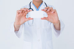 Doctor holding card Royalty Free Stock Photography