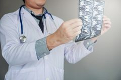 Doctor holding and checking chest x-ray film or roentgen image i. N ward hospital Royalty Free Stock Image