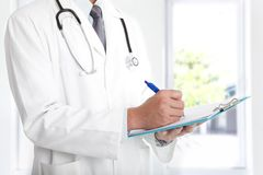Doctor holding clipboard Stock Photos