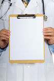 Doctor holding clipboard Stock Images