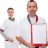 Doctor is holding a clipboard Royalty Free Stock Photos