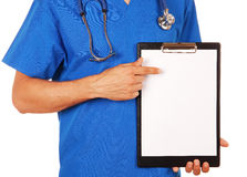 Doctor holding clipboard with blank sheet of paper  isolated ove Stock Image