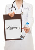 Doctor holding a clipboard and a bottle of water Stock Image