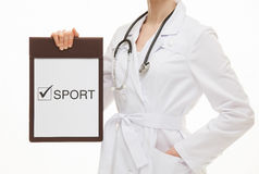 Doctor holding a clipboard and calling to healthy lifestyle Stock Images