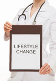 Doctor holding a clipboard and calling to healthy lifestyle Royalty Free Stock Photography